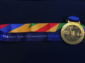 Hard earned -- the 2014 TCS NYC Marathon medal.